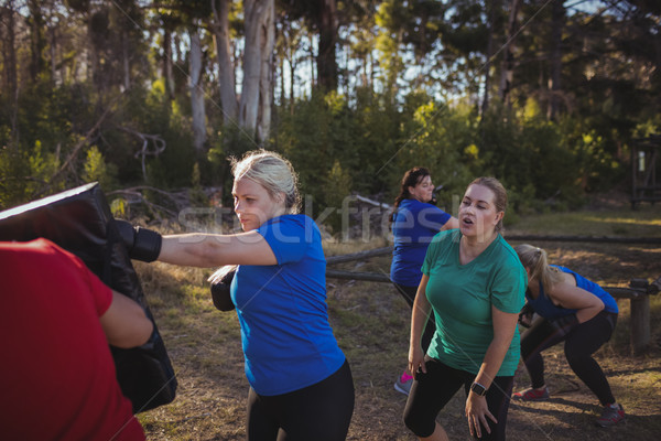 Woman practicing boxing in the boot camp Stock photo © wavebreak_media
