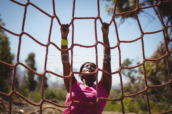 Kadın tırmanma net çizme Stok fotoğraf © wavebreak_media