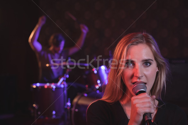 Portrait of female singer performing with male drummer Stock photo © wavebreak_media