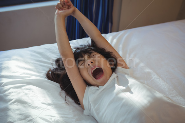 Lány ásít ágy szoba otthon gyermek Stock fotó © wavebreak_media