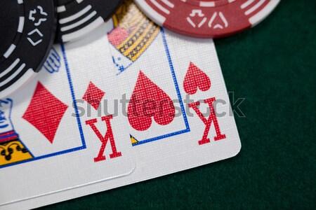 Playing cards arranged on poker table Stock photo © wavebreak_media