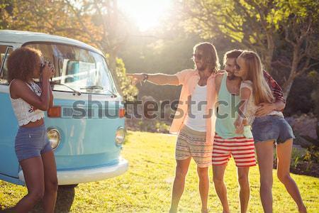 Happy friends dancing on field Stock photo © wavebreak_media