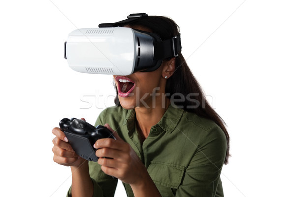 Woman playing video game with virtual reality headset Stock photo © wavebreak_media