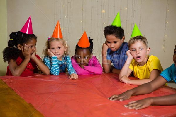 Sıkılmış çocuklar şapka oturma tablo kız Stok fotoğraf © wavebreak_media