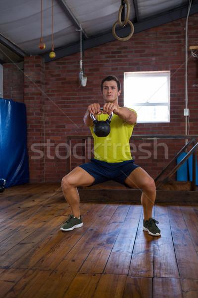Determinato uomo kettlebell fitness studio Foto d'archivio © wavebreak_media