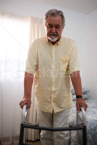 Senior man walking with walker at nursing home Stock photo © wavebreak_media