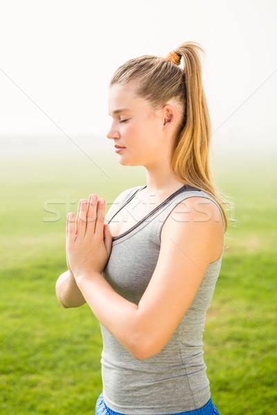 Peaceful sporty blonde meditating  Stock photo © wavebreak_media