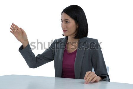 Businesswoman gesturing at desk Stock photo © wavebreak_media