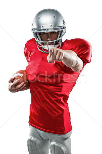 Portrait American football player in red jersey pointing Stock photo © wavebreak_media