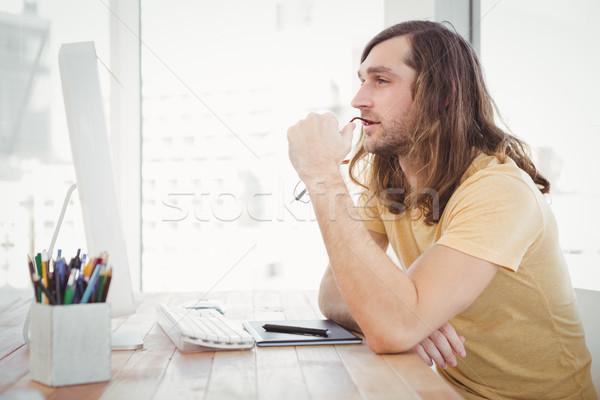Thoughtful hipster at computer desk Stock photo © wavebreak_media