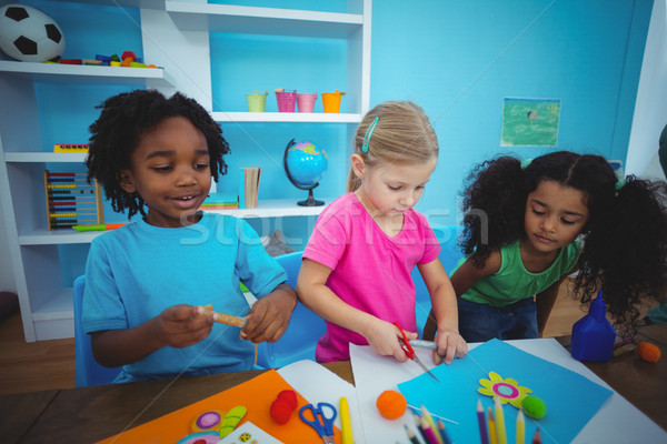 Heureux enfants argile ensemble bureau fille Photo stock © wavebreak_media