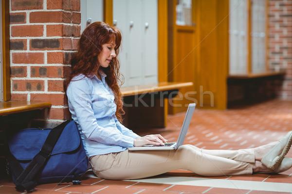 Mature student using laptop in hallway Stock photo © wavebreak_media