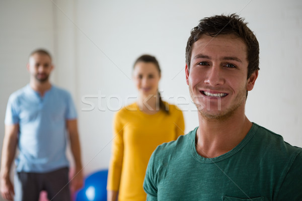 Portrait of man with yoga instructor and woman in club Stock photo © wavebreak_media