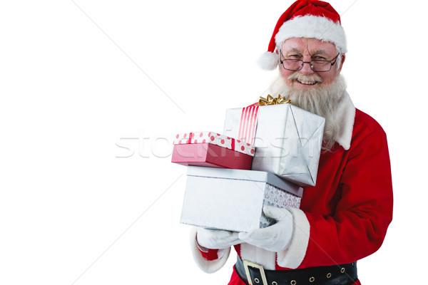 Santa Claus holding gift boxes Stock photo © wavebreak_media