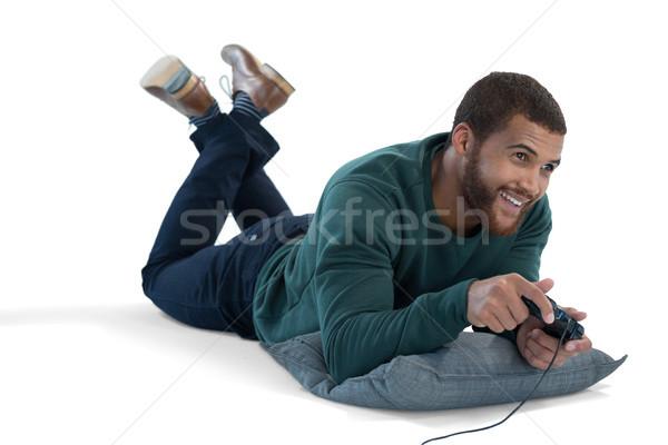 Homme jouer jeu vidéo blanche souriant Homme Photo stock © wavebreak_media