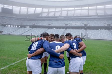 Football players standing in ready position Stock photo © wavebreak_media