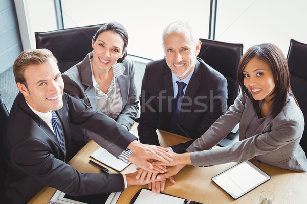 Businesspeople stacking hands in conference room Stock photo © wavebreak_media
