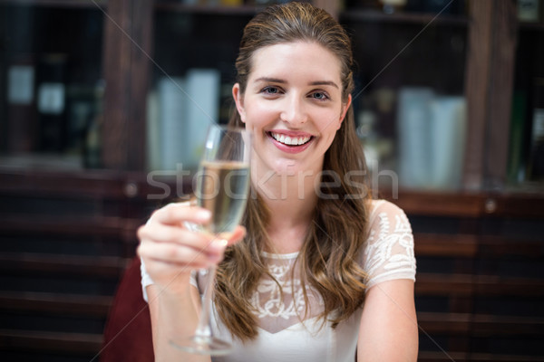 Portrait of happy woman holding champagne flute Stock photo © wavebreak_media