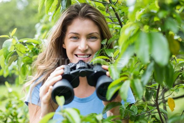 Portrait of smiling woman holding binocular  Stock photo © wavebreak_media