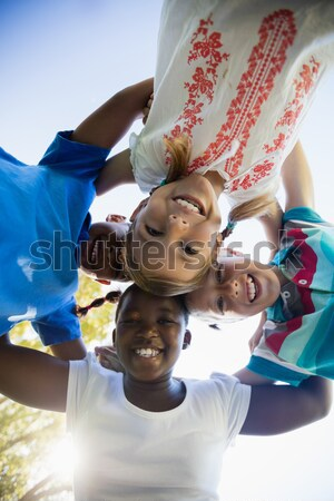 Bottom view of children smiling and looking the camera Stock photo © wavebreak_media