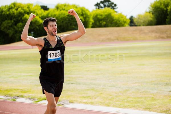 Happy athlete posing after a victory Stock photo © wavebreak_media