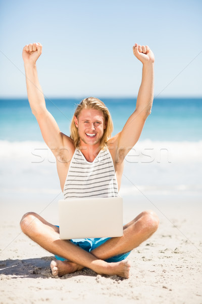 Man using laptop on beach Stock photo © wavebreak_media