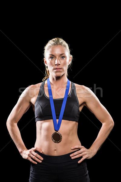 Atléta pózol aranyérem körül nyak fekete Stock fotó © wavebreak_media