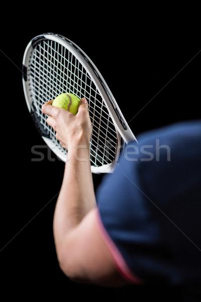 Tennis player holding a racquet ready to serve  Stock photo © wavebreak_media