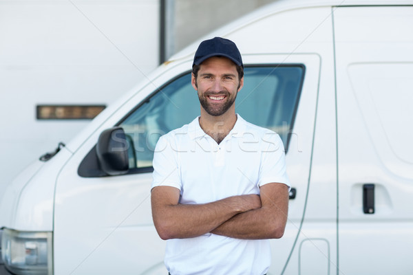Portrait of delivery man is posing with crossed arms Stock photo © wavebreak_media