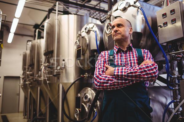 Brewery manufacturer standing by storage tank Stock photo © wavebreak_media