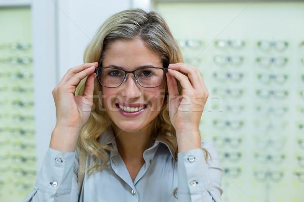 Smiling female customer trying spectacles Stock photo © wavebreak_media