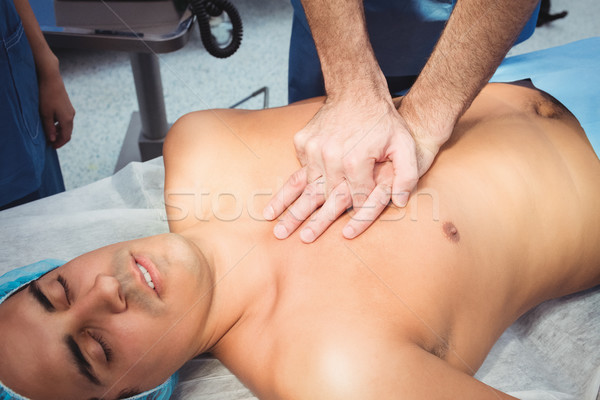 Male surgeon performing cardiopulmonary resuscitation on an unco Stock photo © wavebreak_media