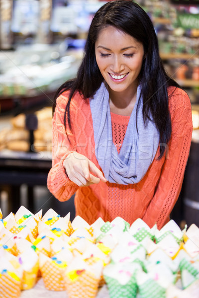 Excited woman looking at cupcakes Stock photo © wavebreak_media