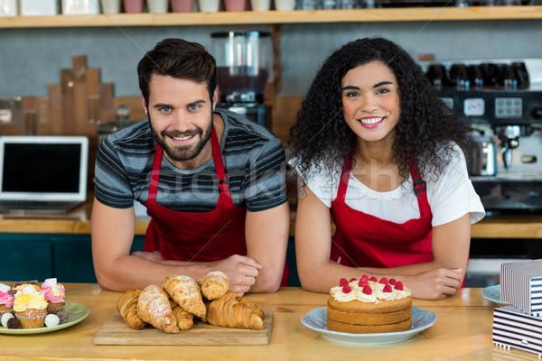 Portrait of waiter and waitress leaning on counter Stock photo © wavebreak_media