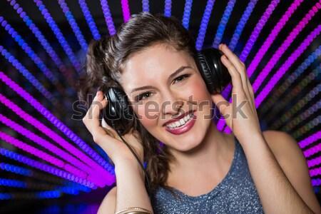 Csinos női játszik zene éjszakai klub nő Stock fotó © wavebreak_media