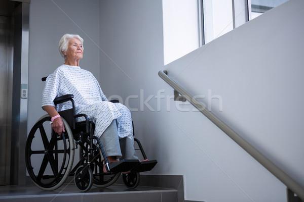 Disabled senior patient on wheelchair near staircase Stock photo © wavebreak_media