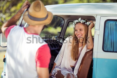 Woman leaning on campervan with camera Stock photo © wavebreak_media