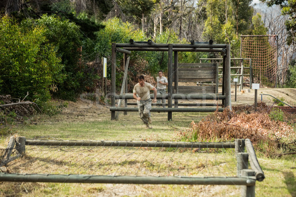 Soldier running through obstacle course Stock photo © wavebreak_media
