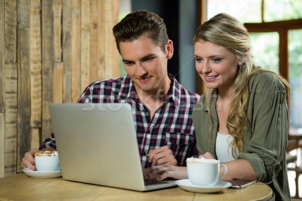 улыбаясь пару используя ноутбук таблице кофейня компьютер Сток-фото © wavebreak_media