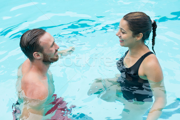 Smiling couple interacting with each other Stock photo © wavebreak_media