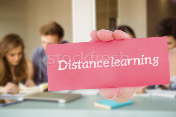 Distance learning against smiling friends students revising toge Stock photo © wavebreak_media