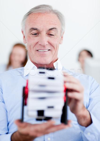 Senior businessman holding a business card holder Stock photo © wavebreak_media