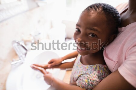 Brilhante mulher leitura sofá sala de estar sorrir Foto stock © wavebreak_media