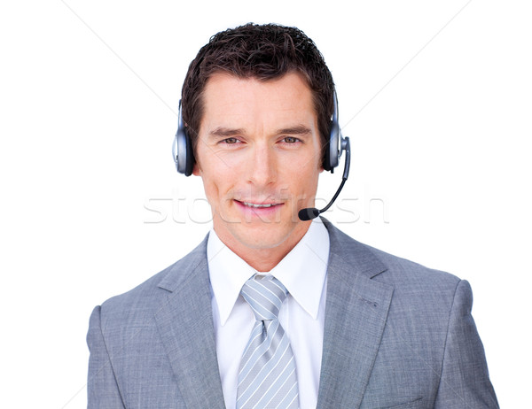 Self-assured businessman using headset Stock photo © wavebreak_media