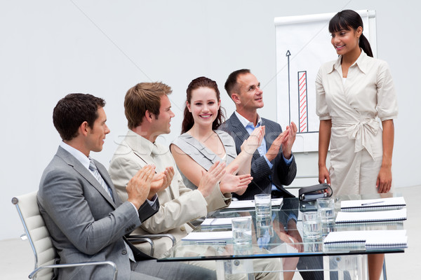 Stock photo: Businesswoman applauding a colleague after giving a presentation