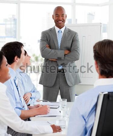 Empresário discutir equipe apresentação negócio mulher Foto stock © wavebreak_media