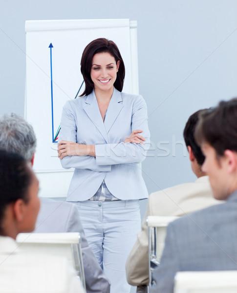 Charming businesswoman doing a presentation  Stock photo © wavebreak_media