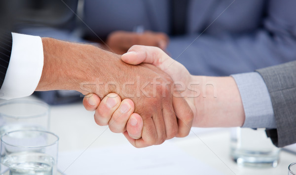 Close-up of confident business people closing a deal Stock photo © wavebreak_media