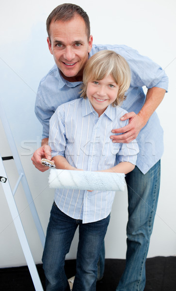 Happy father and his son renovating home Stock photo © wavebreak_media