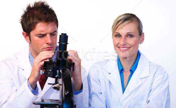 Nauki studentów patrząc mikroskopem uczelni komputera Zdjęcia stock © wavebreak_media